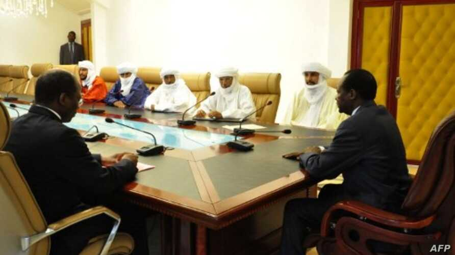 Burkina Faso President Blaise Compaore (R) meets with delegation of Ansar Dine for talks on Mali Nov. 6, 2012 in Ouagadougou