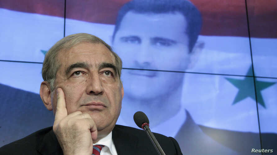 """Qadri Jamil, Syria's deputy prime minister for economic affairs, listens during a news conference in Moscow, August 21, 2012. The Syrian government said on Tuesday foreign military intervention in Syria was """"impossible"""" because it would lead to a con"""