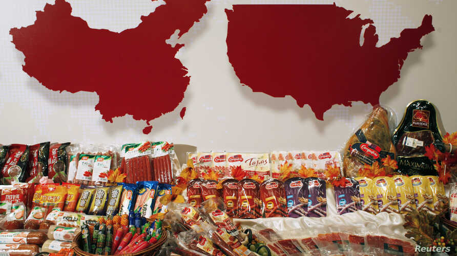 FILE - Products of WH Group are displayed in Hong Kong April 14, 2014. WH Group bought U.S.-based Smithfield Foods in 2013.