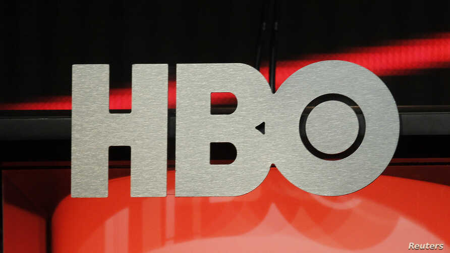 FILE - The logo for HBO,Home Box Office, the American premium cable television network, owned by Time Warner, is pictured in Beverly Hills, California,  Aug.1, 2012.