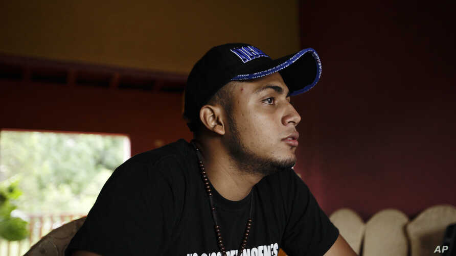 Jairo Bonilla, wearing a #WeAren'tCriminals T-shirt, gives an interview at a safe house in Nicaragua, July 28, 2018. The 20-year-old, a leader of student protests against President Daniel Ortega's government, is in hiding, trying to ignore the threat