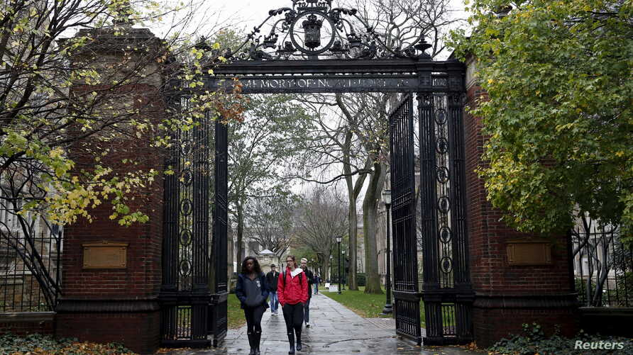 Students walk on the campus of Yale University in New Haven, Connecticut, Nov. 12, 2015.