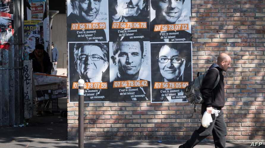 """Posters of French presidential election candidates as part of a campaign of """"Solidarite Sida"""" in Paris, France, April 19, 2017."""