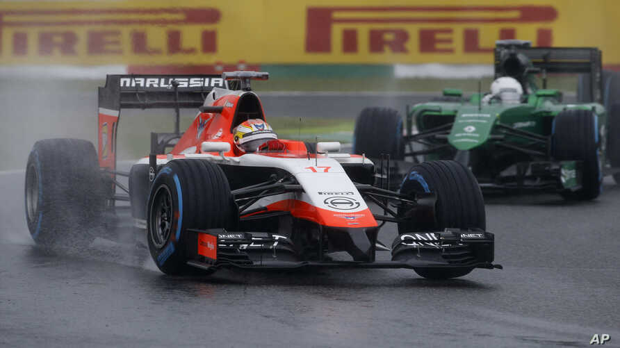 Marussia driver Jules Bianchi of France leads Caterham driver Kamui Kobayashi of Japan during the Japanese Formula One Grand Prix at the Suzuka Circuit in Suzuka, central Japan, Sunday, Oct. 5, 2014.