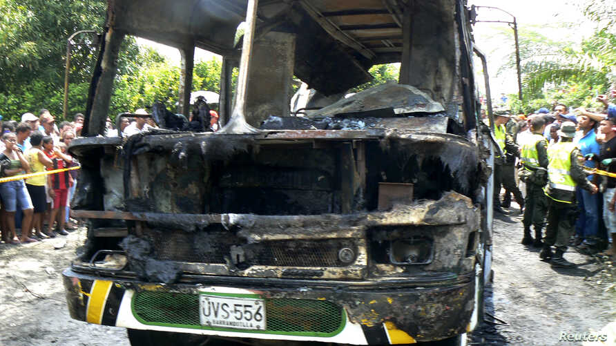 The charred remains of a bus, in which 31 children died, is seen in Fundacion, northern Colombia, May 18, 2014.