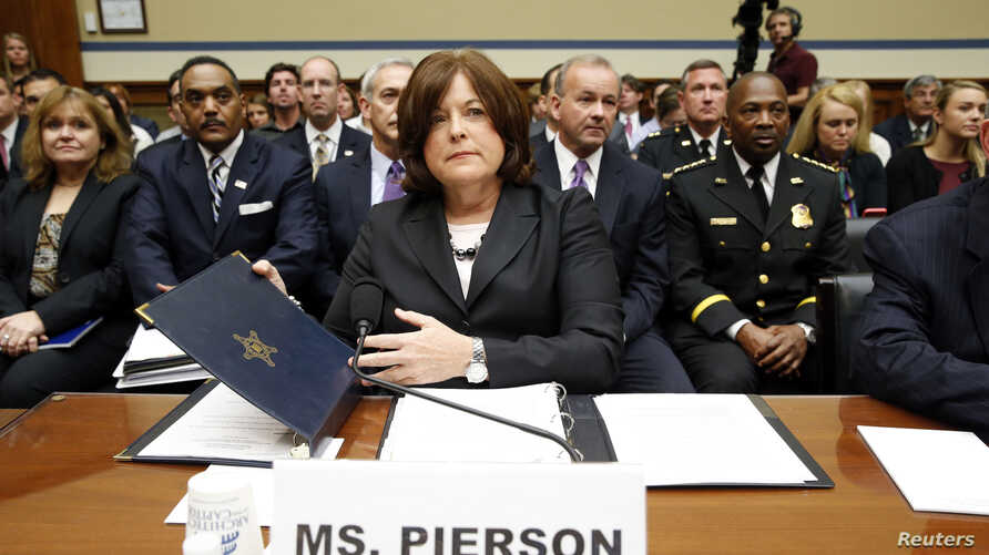 "U.S. Secret Service Director Julia Pierson takes her seat to testify at the House Oversight and Government Reform Committee hearing on ""White House Perimeter Breach: New Concerns about the Secret Service"" on Capitol Hill in Washington, Sept. 30, 2014"