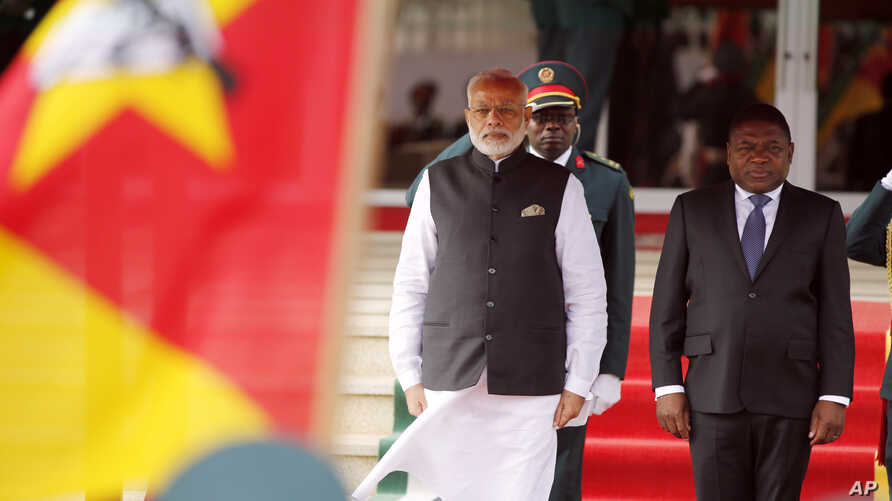 Indian Prime Minister Narendra Modi stands next to Mozambique's President Filipe Nyusi, right, during a guard of honor in Maputo, Mozambique on July 7, 2016.