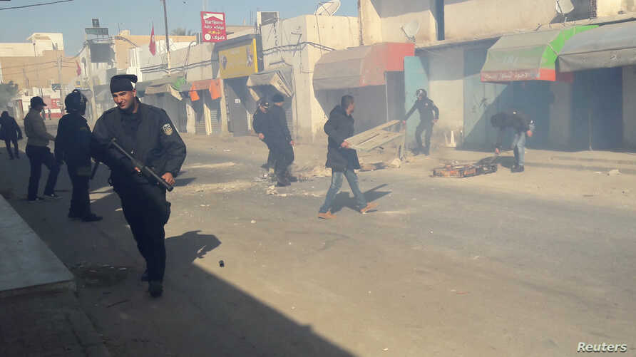 Riot police officers clean up after clashing with protesters protesting over jobs and a lack of development, in Ben Guerdane, Tunisia, Jan. 12, 2017.