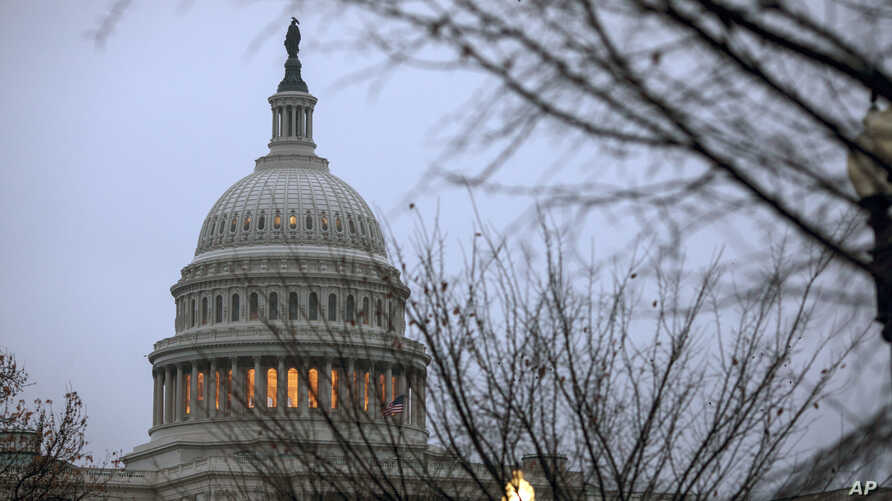 The Capitol is seen in Washington, Dec. 5, 2017, days before President Trump signed a stopgap measure gives lawmakers and the White House until Dec. 22 to work out a final spending bill that will keep the lights on.