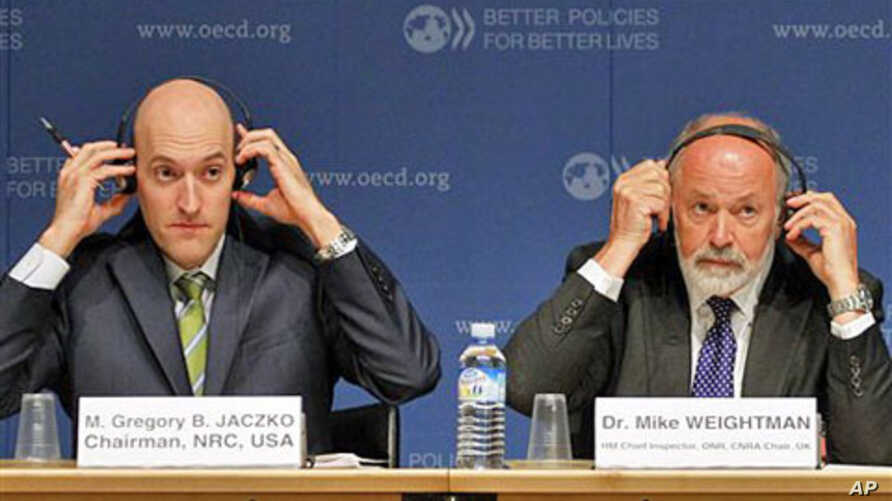 Gregory B. Jaczko, Chairman of the US Nuclear Regulatory Commission, left and Dr Mike Weightman Chief Inspector and Chairman of Britain Nuclear Safety Directorate, during a press conference on the disaster of Japan's Fukushima plant, at the OECD in P