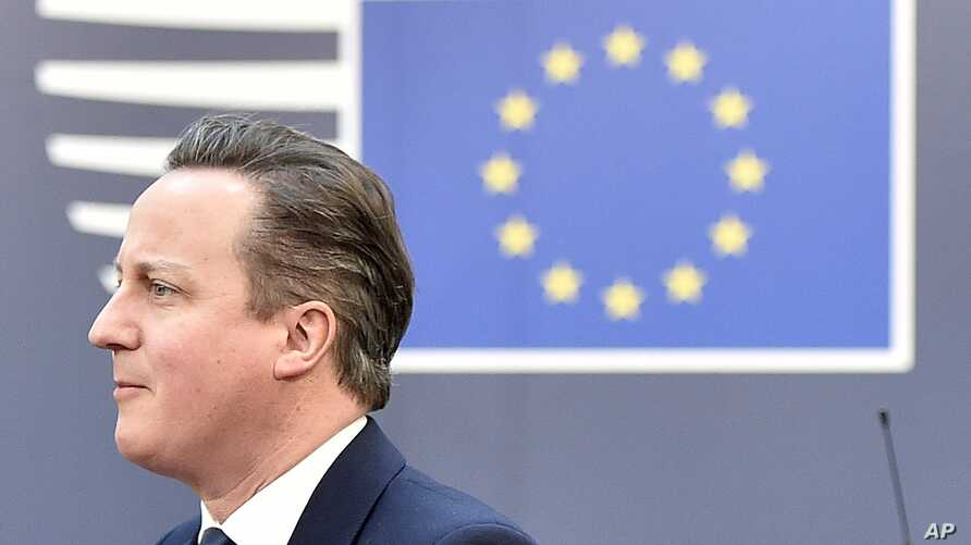 FILE - British Prime Minister David Cameron arrives for an EU summit at the EU Council building in Brussels, Feb. 19, 2016.