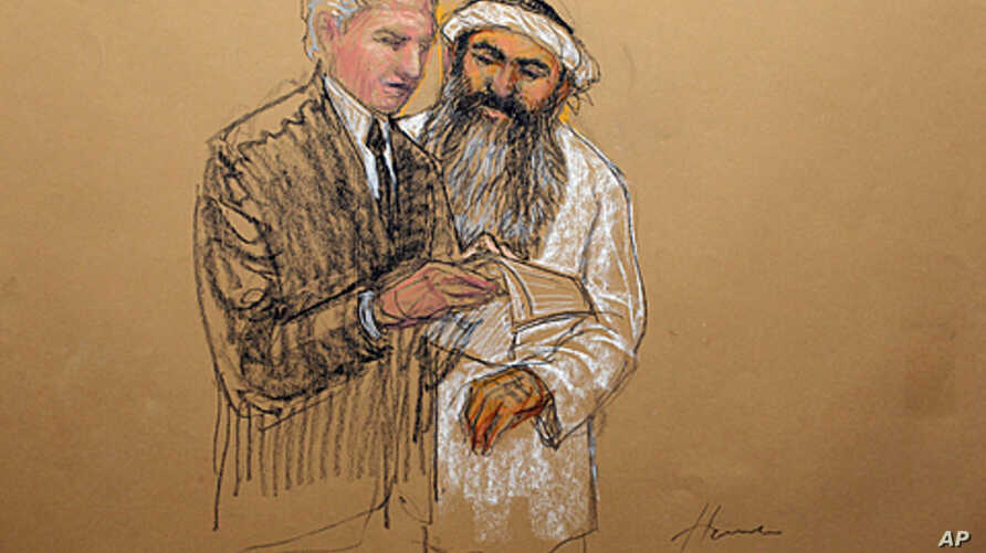 In this photo of a sketch by courtroom artist Janet Hamlin and reviewed by the U.S. Department of Defense, Khalid Sheikh Mohammed consults with his civilian attorney David Nevin during a break of his military hearing at the Guantanamo Bay U.S. Naval