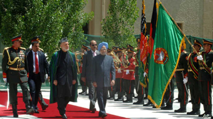 Indian Prime Minister. Manmohan Singh with the President of Afghanistan,  Hamid Karzai inspecting the Guard of Honor, at a ceremonial reception, on his arrival at Kabul airport in Afghanistan on May 12, 2011.