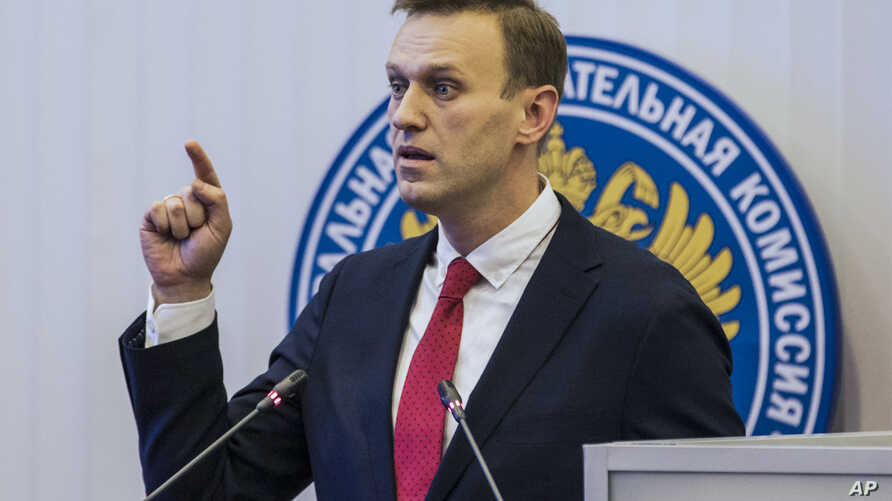 Russian opposition leader Alexei Navalny, who submitted endorsement papers necessary for his registration as a presidential candidate, speaks at the Russia's Central Election commission in Moscow, Dec. 25, 2017.