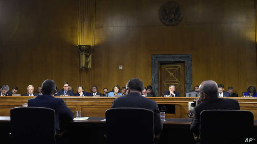 Witnesses testify on allegations of Russia's meddling in the 2016 U.S. presidential elections at a Senate Intelligence Committee hearing on Capitol Hill in Washington, March 30, 2017.