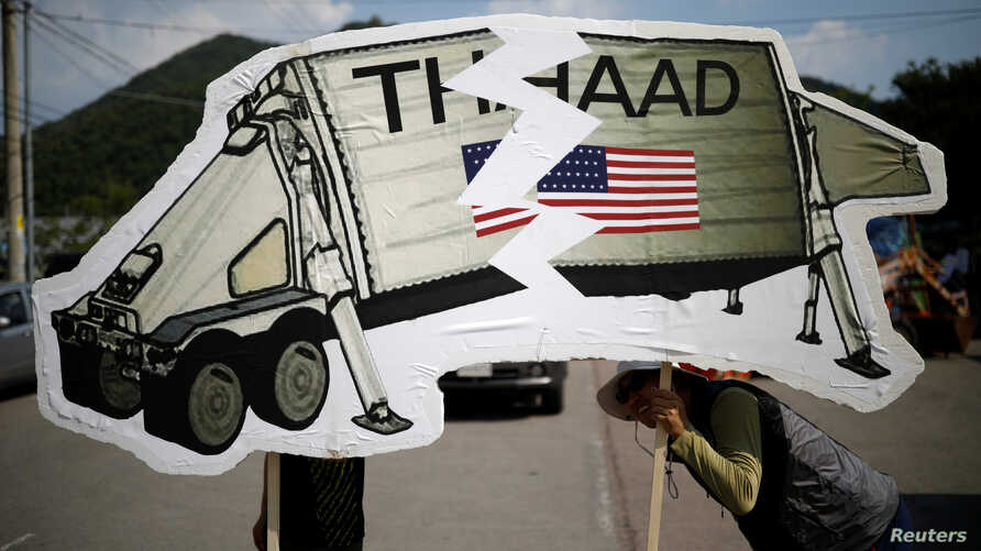 FILE - Protesters attend an anti-THAAD proest in Seongju, South Korea.