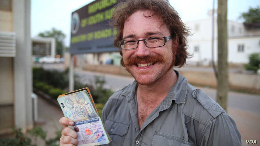 Graham Hughes brandishing his latest visa outside South Sudan's Ministry of Roads in the capital Juba. The 33-year-old Liverpudlian broke a world record Monday when he reached South Sudan, the last on his list of 201 sovereign states to visit without