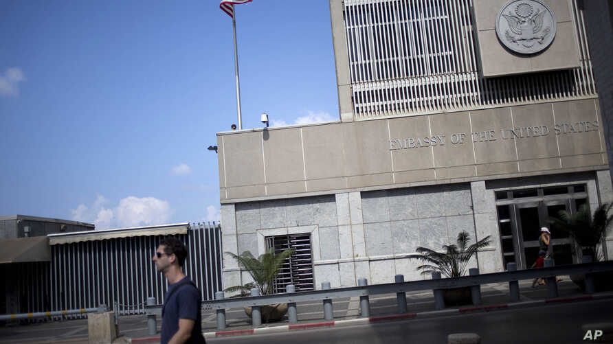 A man walks past the U.S Embassy in Tel Aviv, Israel, Aug. 4, 2013. President-elect Donald Trump has said he would like to move the embassy to Jerusalem.