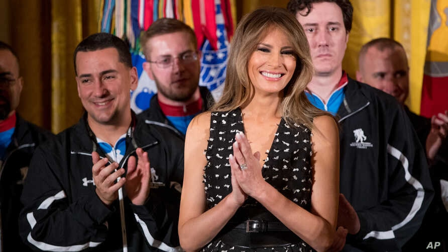 First lady Melania Trump smiles as she attends a Wounded Warrior Project Soldier Ride event in the East Room of the White House, April 6, 2017, in Washington.