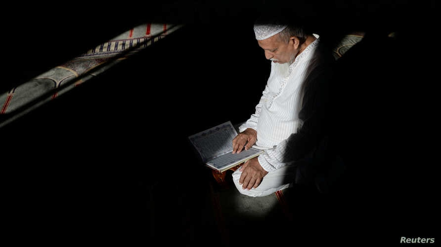 Abdul Barek Hajji, 70, a Bengali Muslim, reads the Koran while waiting for the Maghrib sunset prayer during Ramadan at the  Abu Bakr Mosque in Flushing, New York, May 31, 2017.