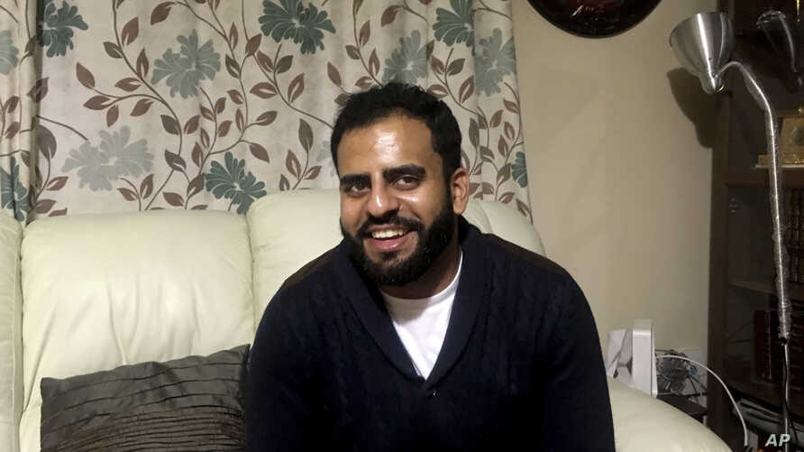 In this Nov. 21, 2017 photo, Irishman Ibrahim Halawa, who was recently acquitted after four years of imprisonment in Egypt, poses for a photograph at his home, in Dublin, Ireland. Halawa says he saw dozens of cellmates radicalize and adopt views of t