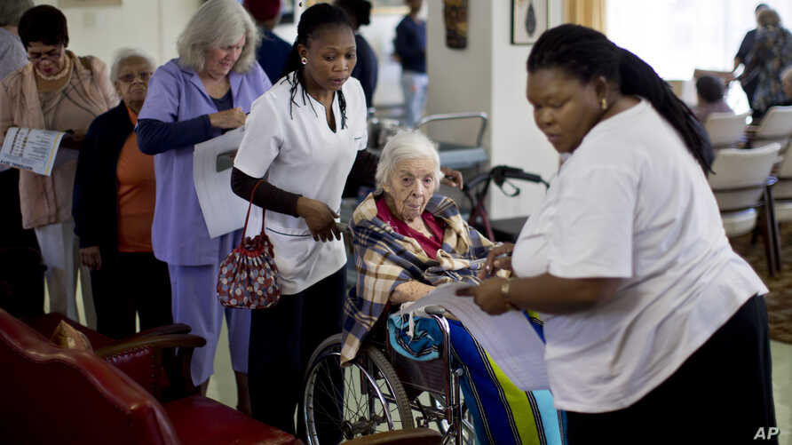 Elderly and disabled South African voters, assisted by nurses, cast their ballots during early voting for special groups at the Nazareth House old-age home in Johannesburg, South Africa, May 5, 2014.