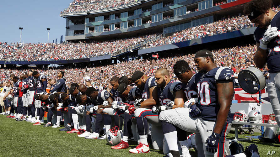 Several New England Patriots players kneel during the national anthem before an NFL football game against the Houston Texans, Sept. 24, 2017, in Foxborough, Mass.