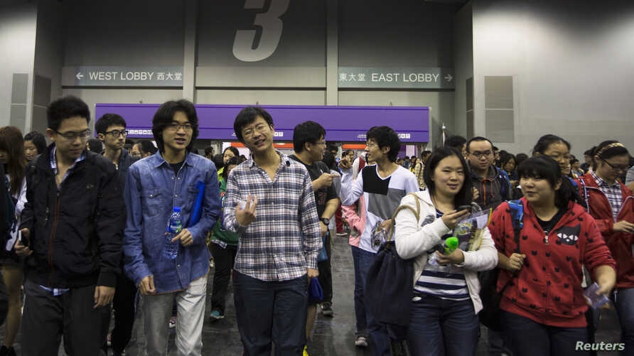 FILE - Students leave after a Scholastic Assessment Tests (SAT) exam at AsiaWorld-Expo in Hong Kong, Nov. 2, 2013.