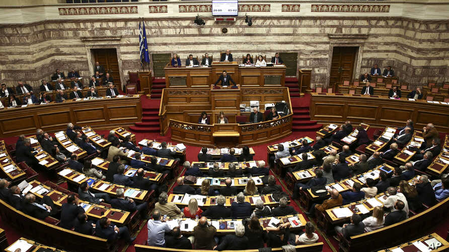 Greece's Prime Minister Alexis Tsipras addresses lawmakers on a controversial austerity bill during a parliamentary session in Athens, May 8, 2016. The bill passed early Monday morning.