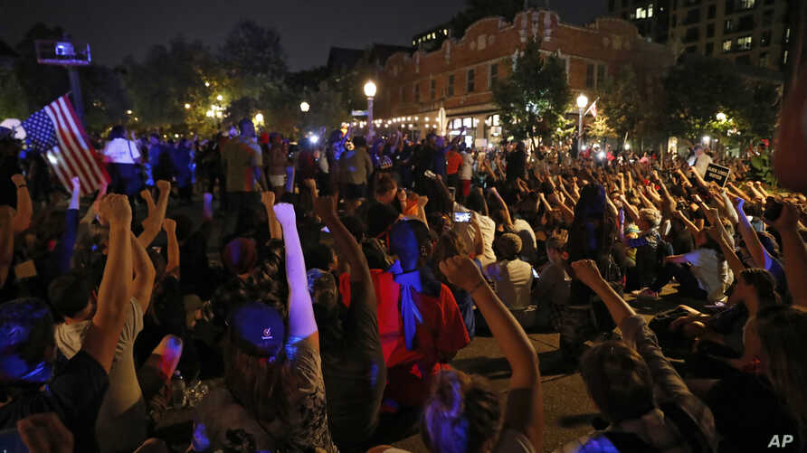 Protesters gather, Sept. 15, 2017, in St. Louis, after a judge found a white former St. Louis police officer, Jason Stockley, not guilty of first-degree murder in the death of a black man, Anthony Lamar Smith, who was fatally shot following a high-sp