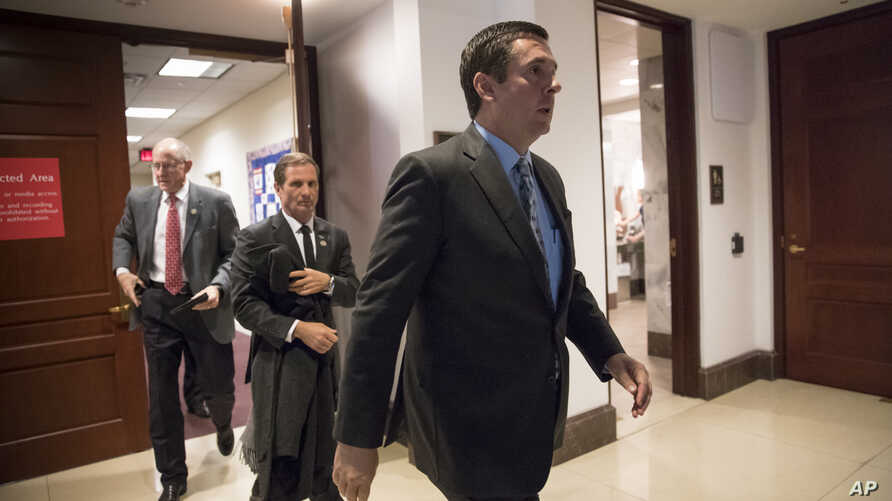 House Intelligence Committee Chairman Devin Nunes, R-Calif., followed by Rep. Chris Stewart, R-Utah, and Rep. Mike Conaway, R-Texas, far left, leave the secure area where the panel was wrapping up its inquiry into Russian meddling in the 2016 electio...