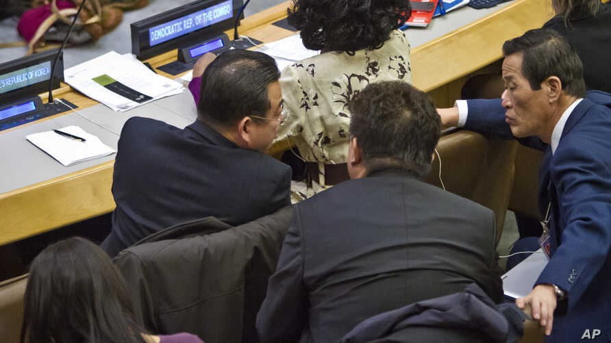 FILE - North Korean officials are seen conferring during a meeting of the U.N. General Assembly human rights committee Nov. 18, 2014.