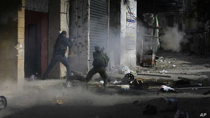 A member of the Palestinian Fateh Movement fires an RPG during a clashes that erupted between the Palestinian Fatah Movement and Islamists in the Palestinian refugee camp of Ein el-Hilweh near the southern port city of Sidon, Lebanon, April 9, 2017.