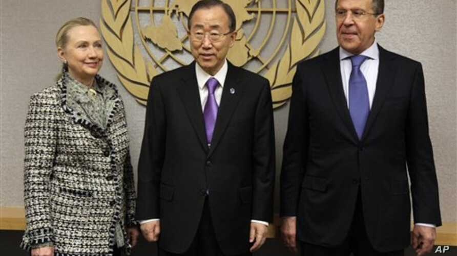 U.S. Secretary of State Hillary Rodham Clinton, and Russian Foreign Minister Sergei Lavrov flank U.N. Secretary-General Ban Ki-moon, center, at United Nations headquarters, March 12, 2012.