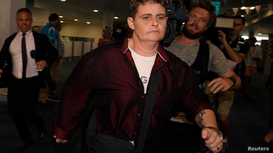 Bali Nine drug smuggler Renae Lawrence runs through the terminal as she arrives at Newcastle airport in Newcastle, Australia, Nov. 22, 2018.
