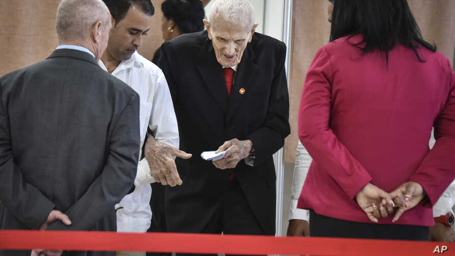 FILE - Former military commnader Jose Ramon Fernandez, center, casts his ballot to choose a new leadership for the National Assembly in Havana, Cuba, April 18, 2018.