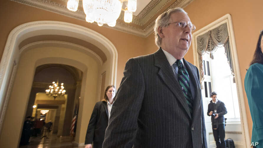 Senate Majority Leader Mitch McConnell walks to the chamber where he offered a tribute to the late Supreme Court Justice Antonin Scalia, on Capitol Hill in Washington, Feb. 22, 2016.