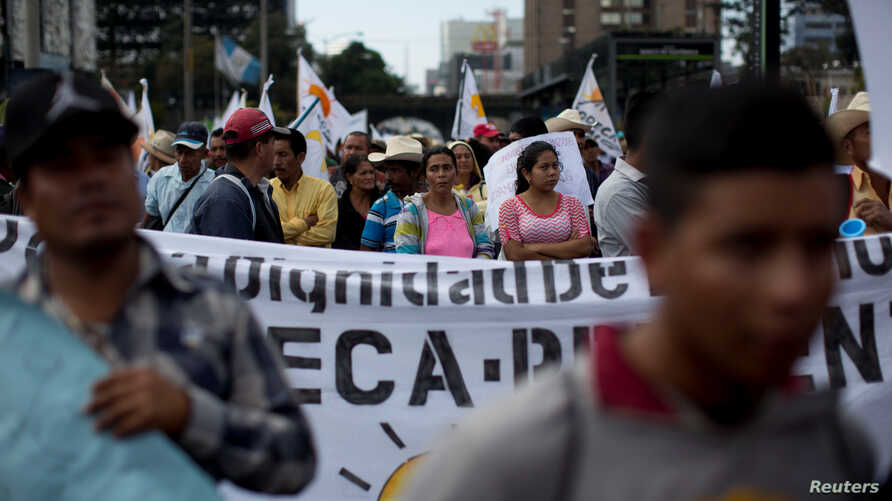 Farmers march to demand the resignation of Guatemala President Jimmy Morales and against the politicians involved with the Odebrecht bribery scheme, in Guatemala City, Guatemala, March 7, 2017.
