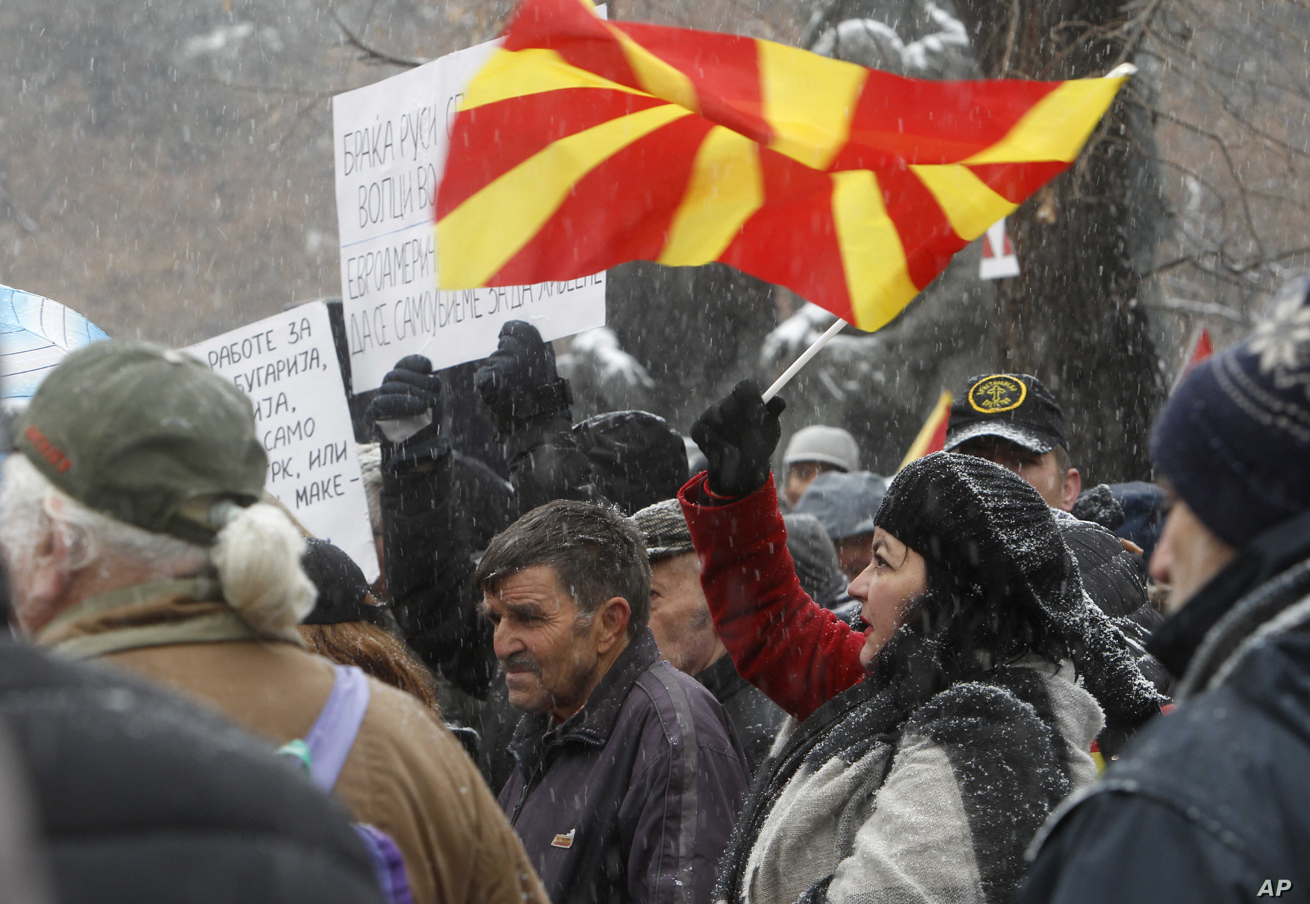 Opponents to the change of the country's constitutional name protest outside the parliament building prior to a session of the Macedonian Parliament in the capital Skopje, Jan. 9, 2019.