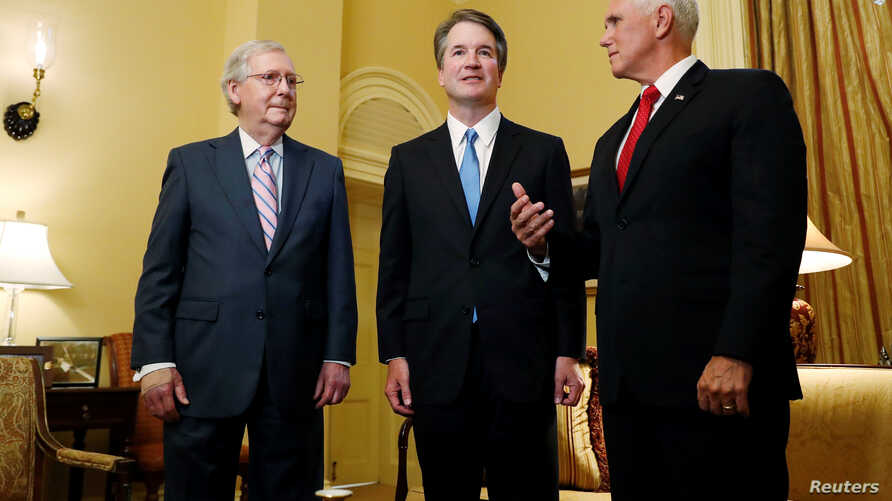 U.S.  Senate Majority Leader Mitch McConnell greets Supreme Court nominee Judge Brett Kavanaugh and Vice Preisdent Mike Pence for a meeting in his office at the U.S. Capitol on Capitol Hill in Washington, July 10, 2018.