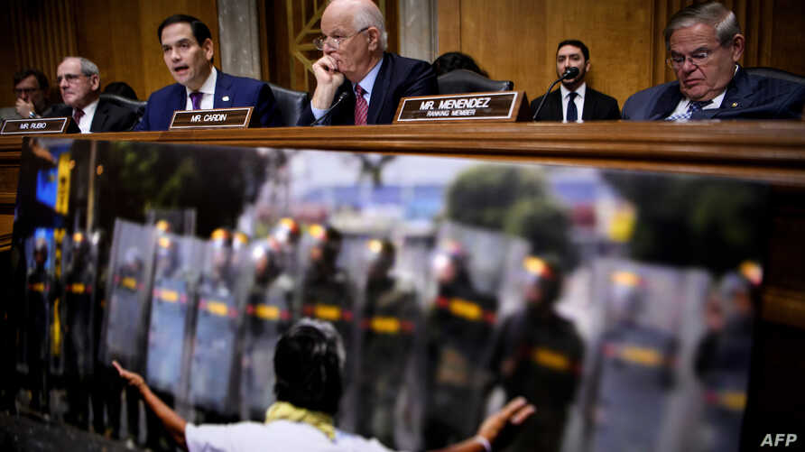 "From left, Senator James E. Risch (R-ID), Senator Marco Rubio (R-FL), Senator Benjamin L. Cardin (D-MD), and Senator Robert Menendez (D-NJ) attend a hearing of the Senate Foreign Relations Subcommittee on ""U.S.-Venezuela Relations and the Path to a D"