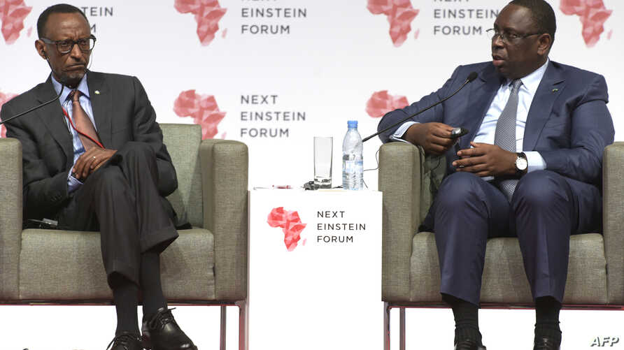 "Senegalese President Macky Sall and Rwandan President Paul Kagame are seen speaking at the opening of the ""Next Einstein Forum"" in Dakar, March 8, 2016."