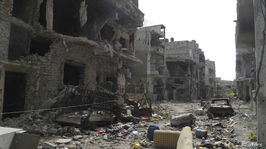 A view shows debris along a street of damaged buildings by what activists said was shelling by forces loyal to Syria's President Bashar al-Assad in Homs, Apr. 8, 2013.