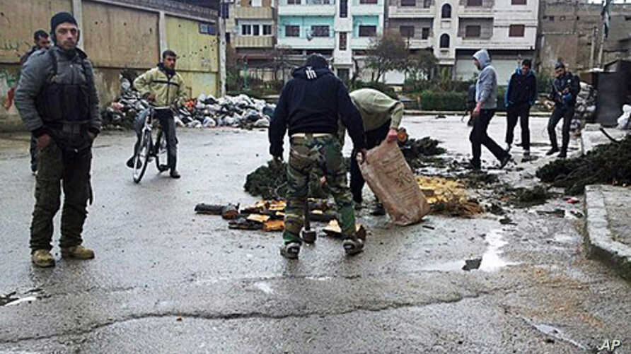 Syrian activists say two foreign journalists were killed Wednesday by government forces shelling the restive central city of Homs, Feb. 22, 2012.