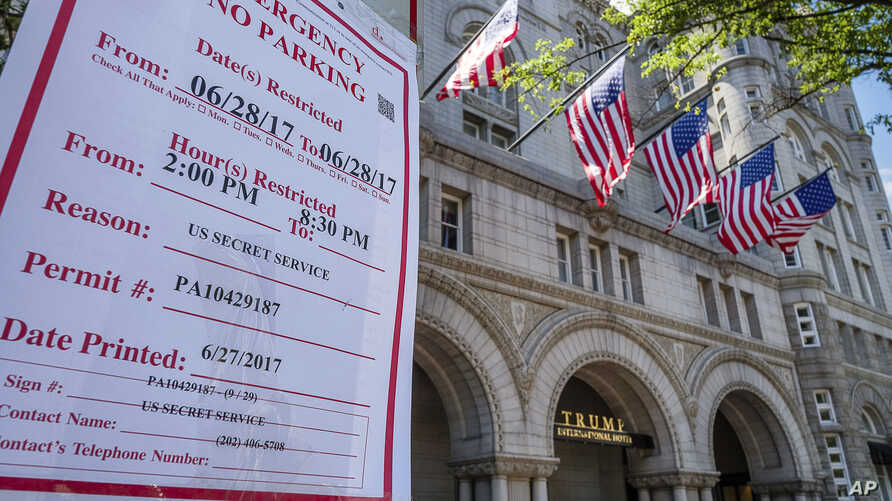 Emergency no parking signs are posted in front of the Trump International Hotel in Washington, June 28, 2017.