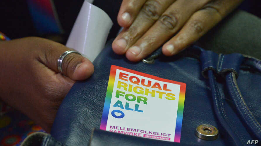 An LGBT activists attends a court hearing in the Milimani high Court in Nairobi, Feb. 20, 2019. Kenya's High Court, Friday, postponed a much-anticipated ruling on whether to scrap colonial-era laws that criminalize homosexuality.