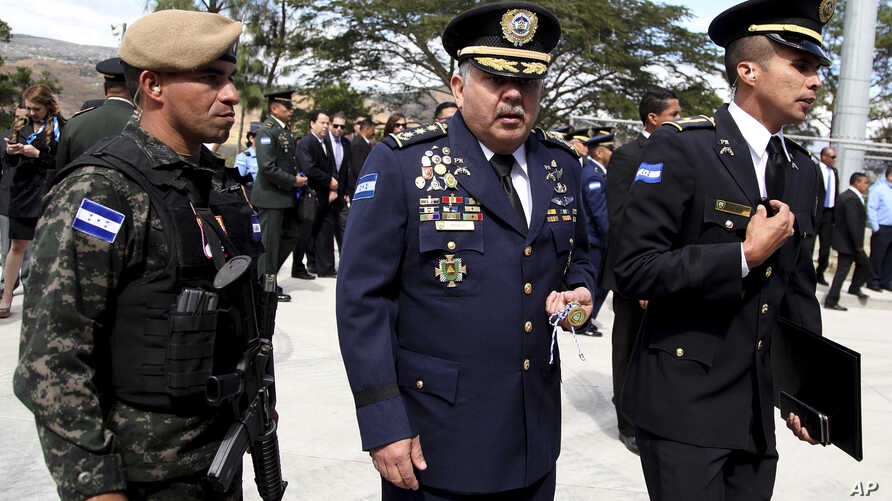 Honduras' new national Police Chief Jose David Aguilar Moran, center, leaves after a ceremony that transferred command to him in Tegucigalpa, Honduras, Jan. 15, 2018. When Aguilar took over as Honduras' new national police chief, he promised to conti