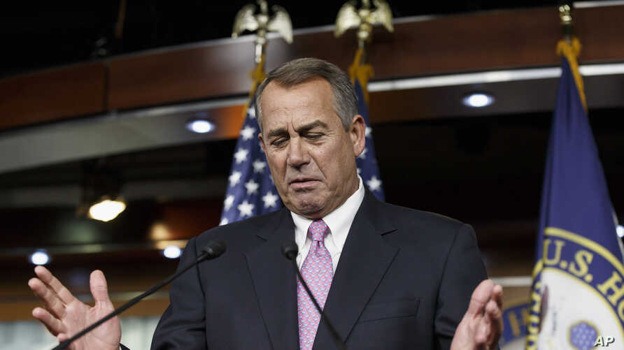 House Speaker John Boehner of Ohio gestures while speaking during a news conference on Capitol Hill in Washington, Feb. 6, 2014.
