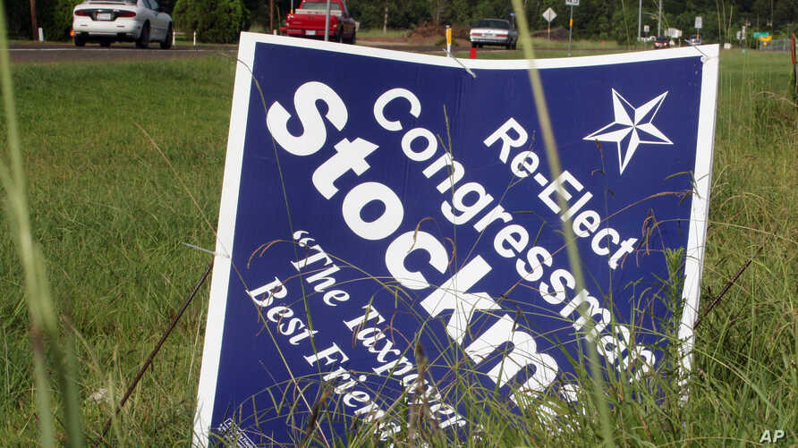 This July 10, 2012, photo shows a campaign sign in Orange, Texas, for Republican congressional candidate Stephen Stockman.