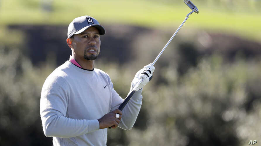 Tiger Woods walks on the 13th fairway of the North Course during the second round of the Farmers Insurance Open golf tournament at Torrey Pines Golf Course in San Diego, Calif., Jan. 27, 2017. It was Woods' first appearance of the season, and he miss